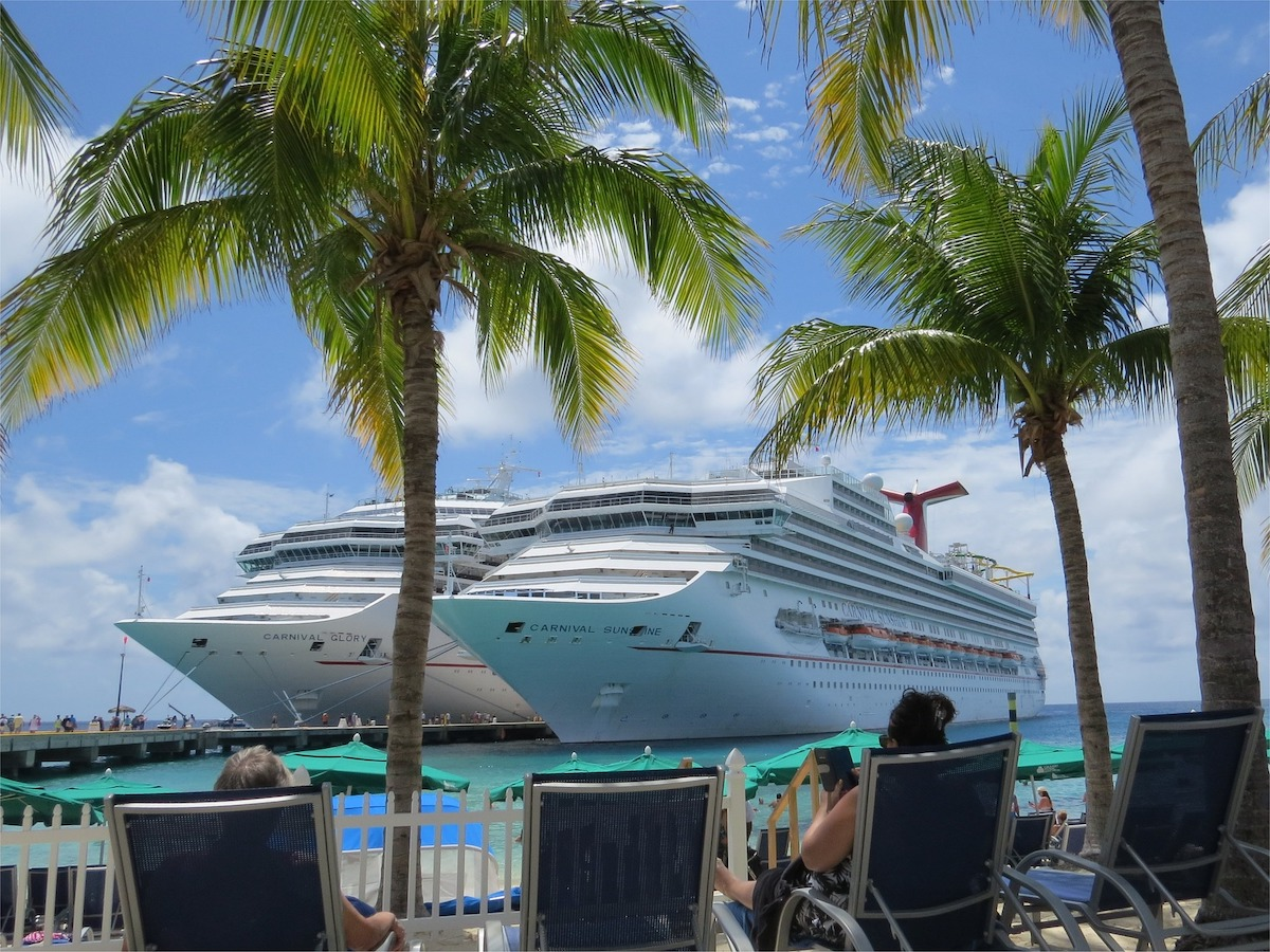 caribbean port carnival cruise ships woman in lounge chair