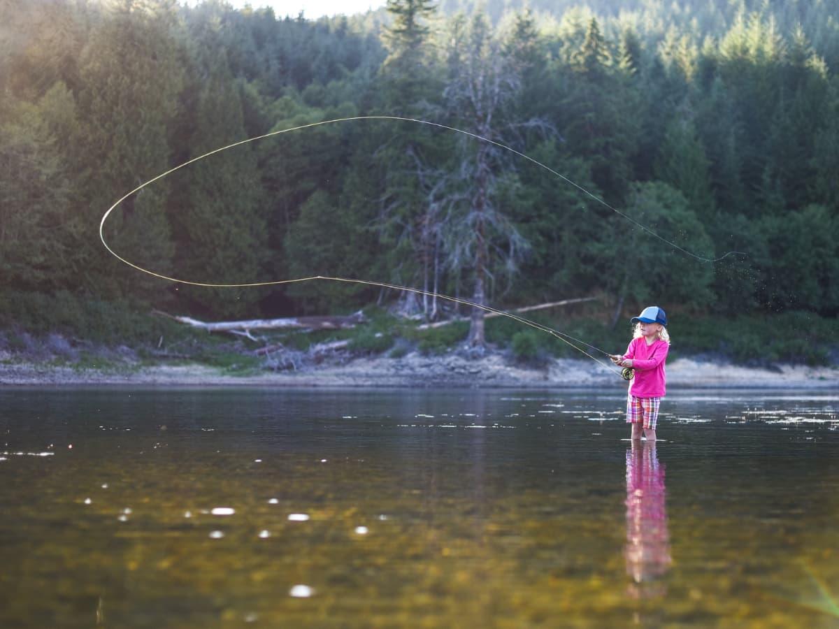 girl fly fisher in stream