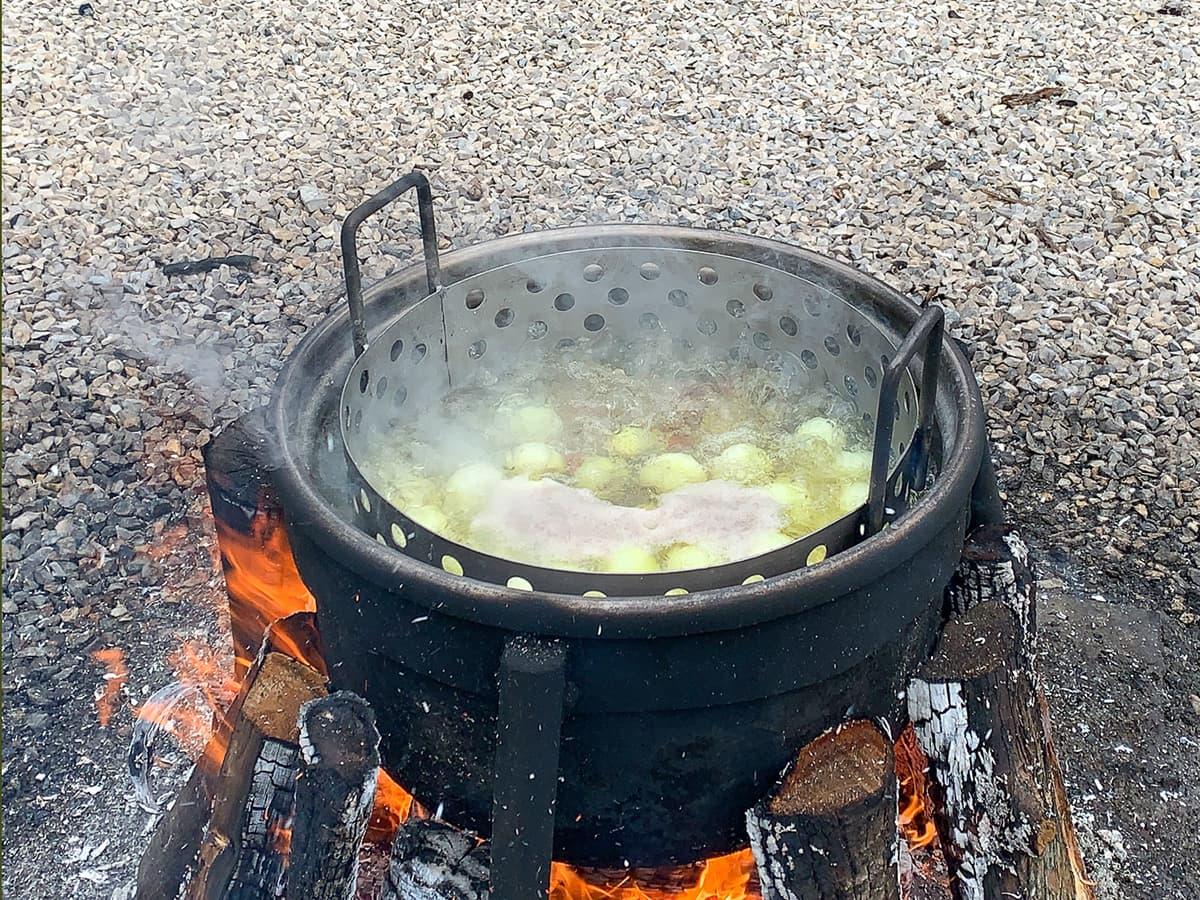 metal cooking pot over fire