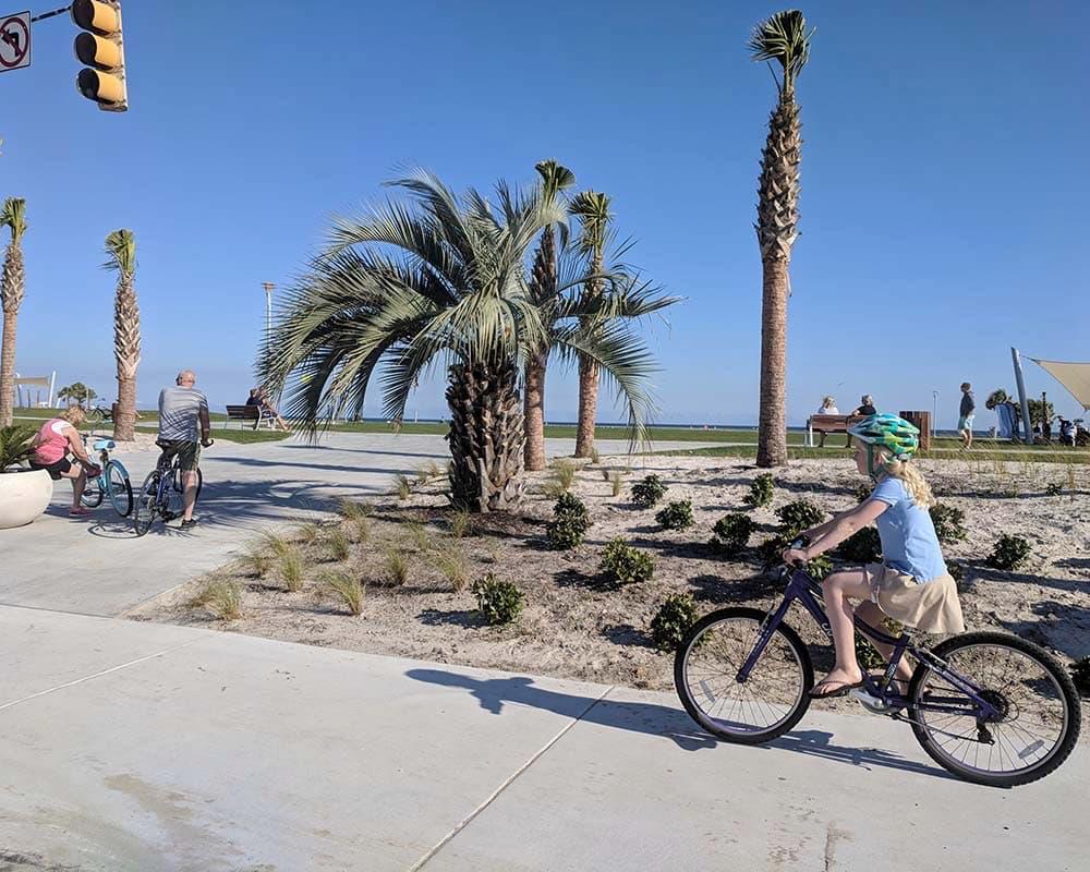 Gulf Shores girl cycling at beach