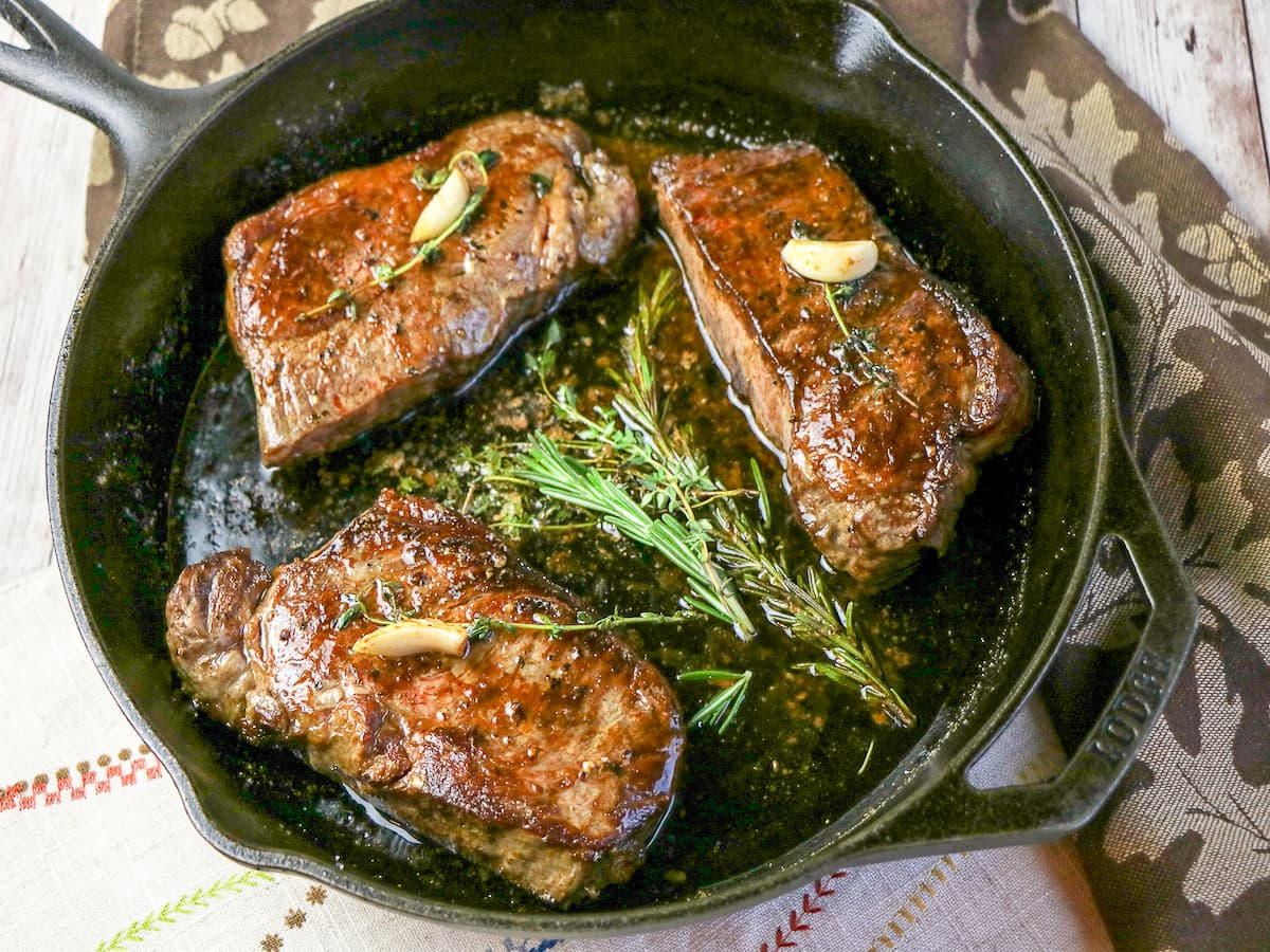 New York Strips in cast iron skillet